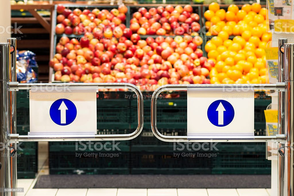 supermarket entrance with background of fruits baskets stock photo