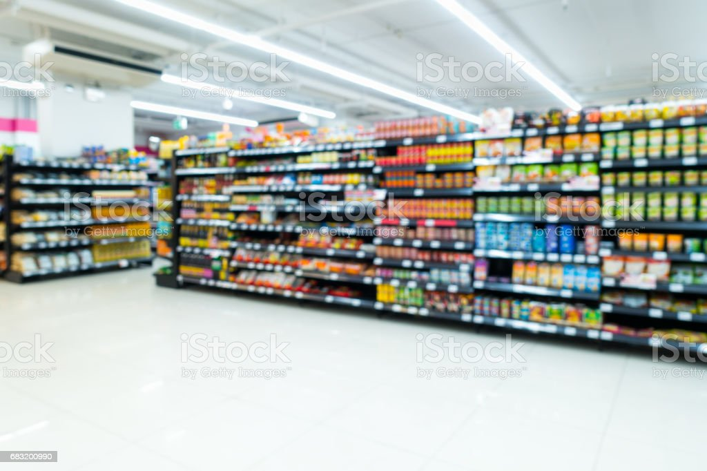 Supermarket goods shelf on blurred. stock photo