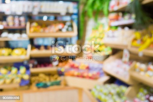 823709528 istock photo Supermarket grocery store with fruit and vegetable on shelves blurred background 905884456