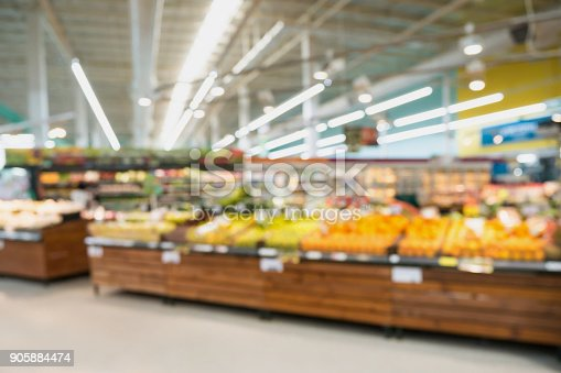 823709528 istock photo Supermarket grocery store with fruit and vegetable on shelves blurred background 905884474