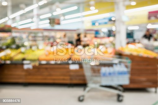 823709528 istock photo Supermarket grocery store with fruit and vegetable on shelves blurred background 905884476