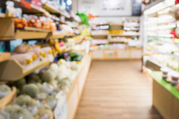 supermarket grocery store with fruit and vegetable on shelves blurred background - prodotti supermercato foto e immagini stock