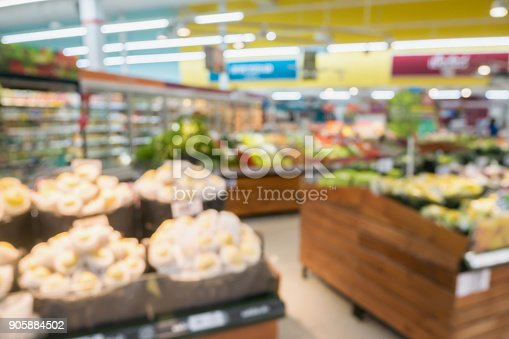 823709528 istock photo Supermarket grocery store with fruit and vegetable on shelves blurred background 905884502