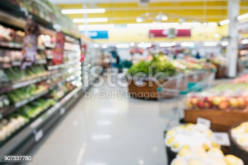 823709528 istock photo Supermarket grocery store with fruit and vegetable on shelves blurred background 907337780