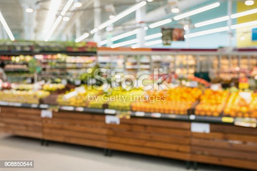 823709528 istock photo Supermarket grocery store with fruit and vegetable on shelves blurred background 908850544