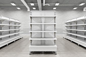 istock Supermarket interior with empty store shelves mock up. 1269284290