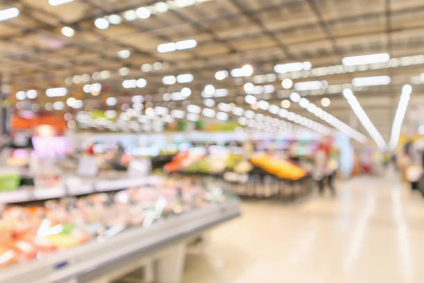 supermarket interior with grocery product blurred defocused background with bokeh light supermarket interior with grocery product blurred defocused background with bokeh light supermarket stock pictures, royalty-free photos & images