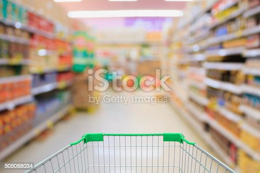 istock Supermarket interior with shopping cart 505068034