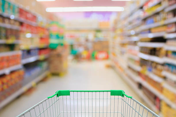 Supermarket interior with shopping cart stock photo