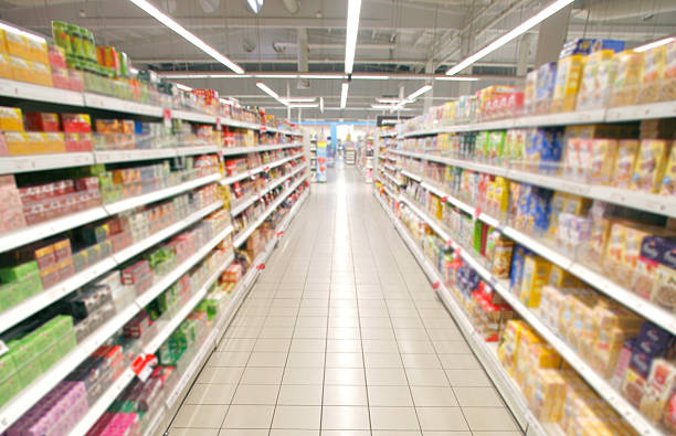 supermarket perspective Wide perspective of empty supermarket aisle aisle stock pictures, royalty-free photos & images
