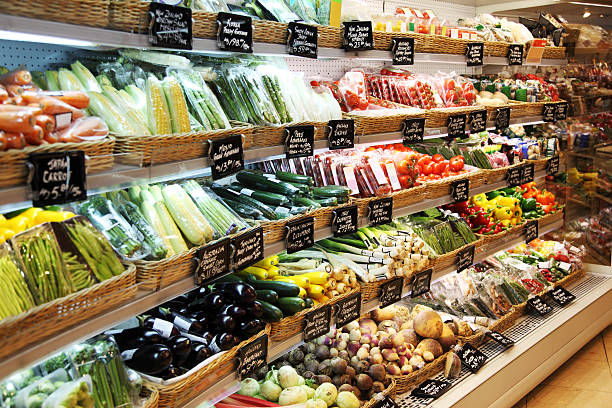 Supermarket Supermarket displaying all kind of organic vegetables. produce aisle stock pictures, royalty-free photos & images