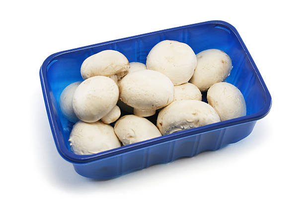 Supermarket Punnet of Mushrooms  fruit carton stock pictures, royalty-free photos & images
