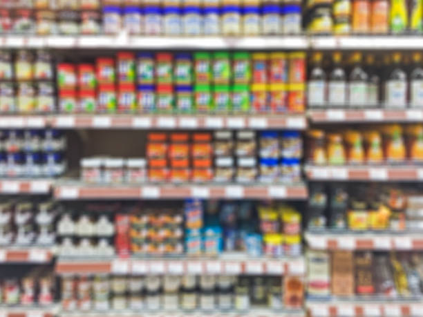 Supermarket shelf defocus background Supermarket shelf defocus background snack aisle stock pictures, royalty-free photos & images