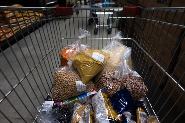 Supermarket Trolley fulfilled with legumes for food supply to survive quarantine days stock photo