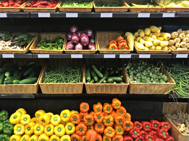 Supermarket vegetable stands Supermarket vegetable stands produce aisle stock pictures, royalty-free photos & images