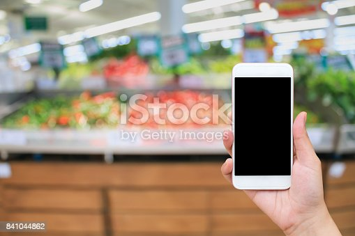823709528 istock photo Supermarket with fresh food abstract blurred background with bokeh light 841044862