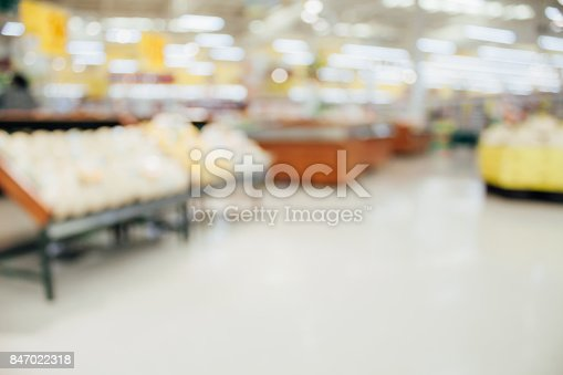823709528 istock photo Supermarket with fresh food abstract blurred background with bokeh light 847022318