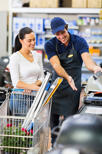 506662064 istock photo supermarket worker help female customer 525883091