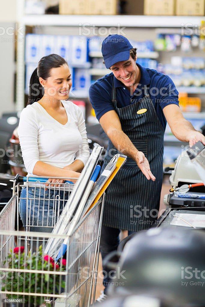 supermarket worker help female customer stock photo