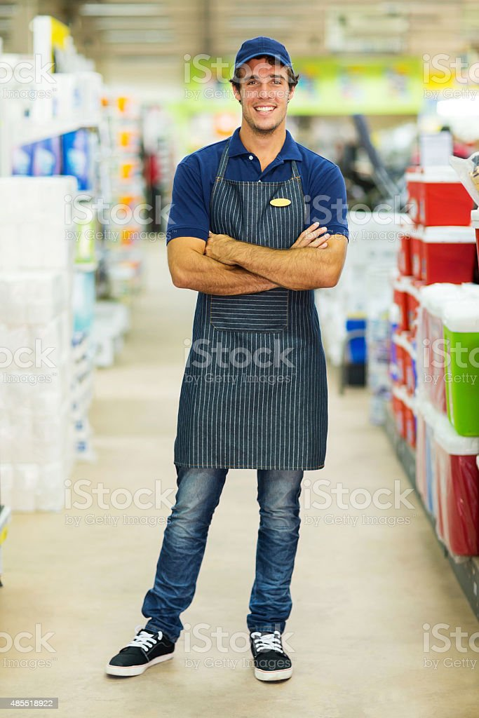 supermarket worker with arms crossed stock photo