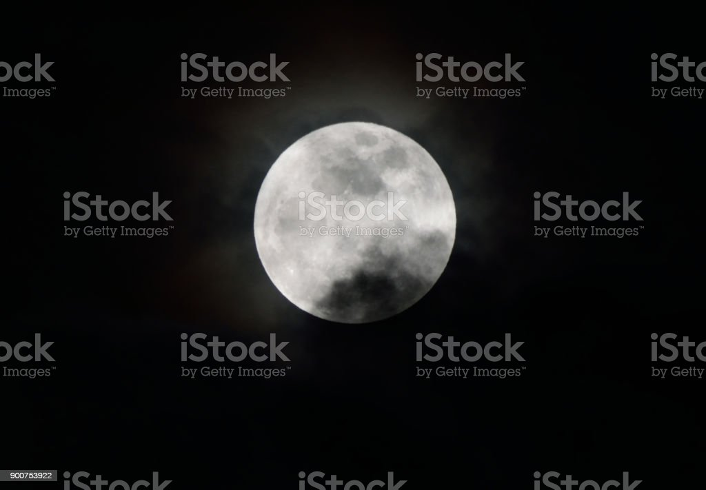 A Supermoon Above the Clouds stock photo