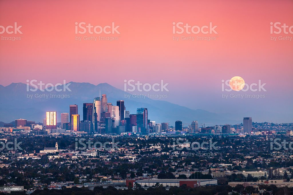 Supermoon Moonrise Over Los Angeles Skyline And San Gabriel Mountains stock photo