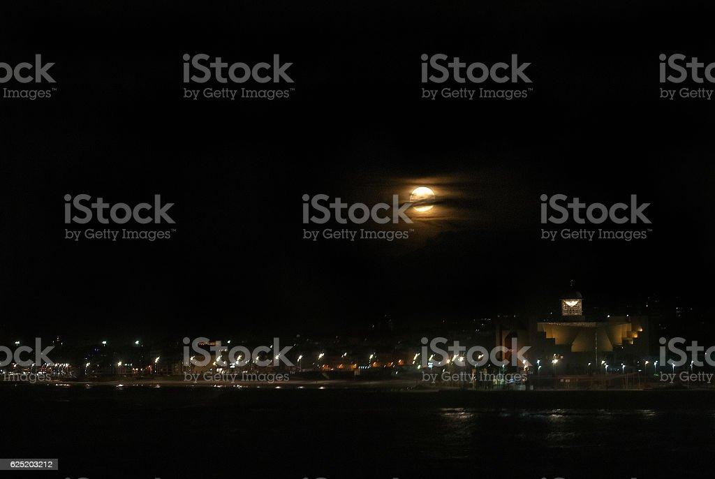 Supermoon over Las Canteras Beach stock photo