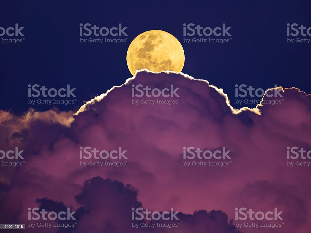 Supermoon rising above thunderstorm stok fotoğrafı