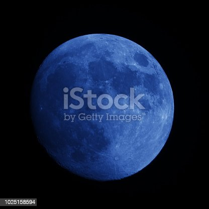 Close-up of a super-resolution blue full moon at night sky, Isolated on black background. Photo take 1200mm(35mm equivalent) Lens on Nikon D810