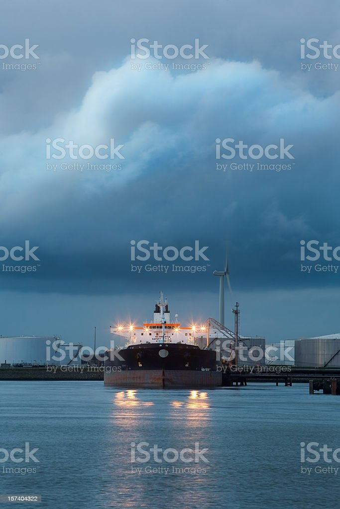 Supertanker at dawn with headlights royalty-free stock photo