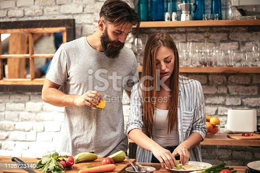 Shot of an attractive young couple cooking together
