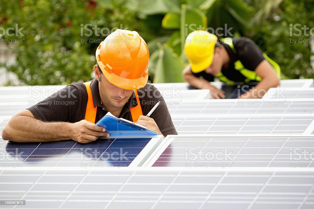 Supervising solar panels royalty-free stock photo