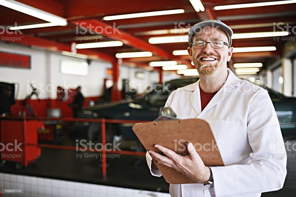 Supervisor at auto workshop royalty-free stock photo