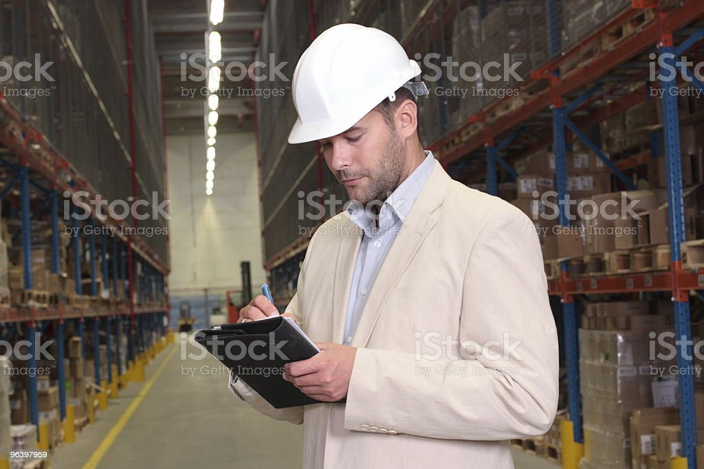 supervisor checking inventory - Royalty-free Abundance Stock Photo