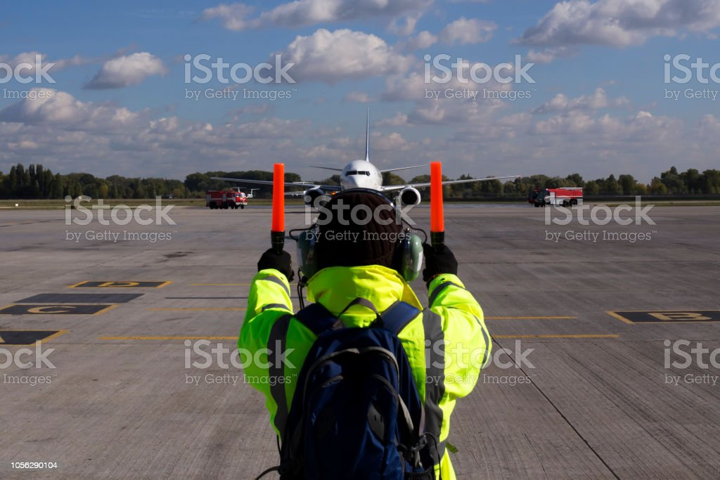 A supervisor helps at the aircraft parking stock photo