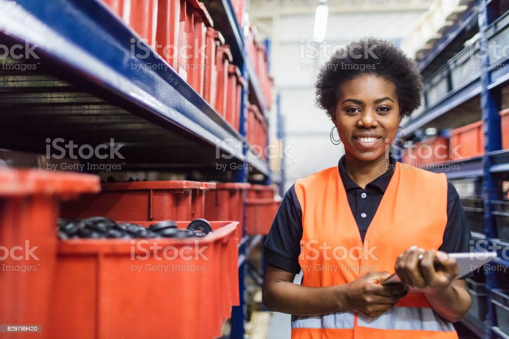 Supervisor stocktaking in company warehouse royalty-free stock photo