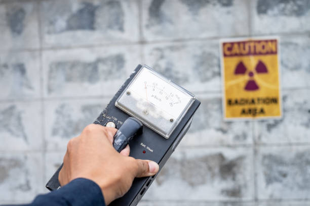 Supervisor use the survey meter to checks the level of radiation in the radioactive zone Supervisor use the survey meter to checks the level of radiation in the radioactive zone radioactive contamination stock pictures, royalty-free photos & images