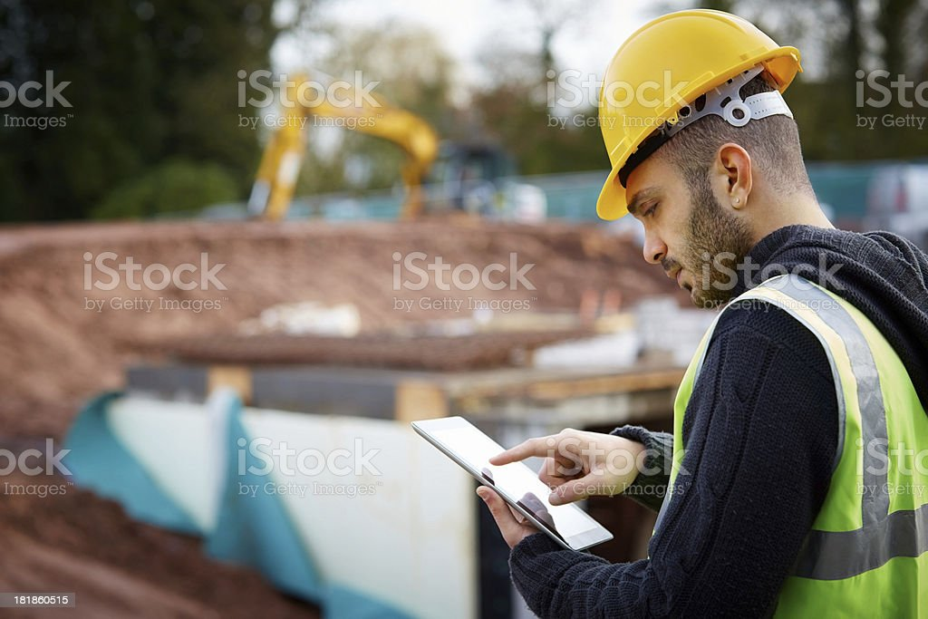 Supervisor with tablet PC at construction site stock photo