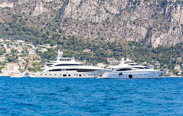 Superyachts near south of France coastline stock photo