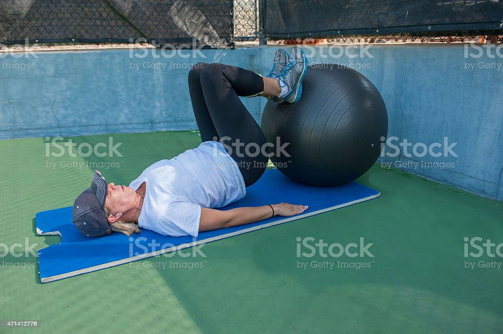 Supine leg curls stock photo