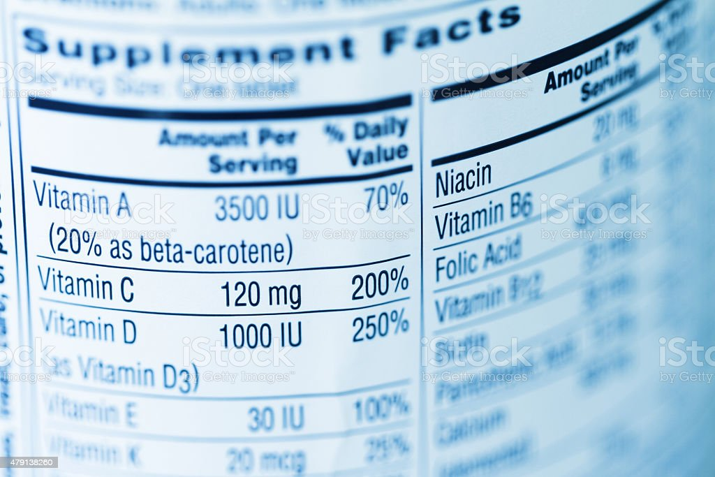 Supplement facts label on a multi vitamin container stock photo