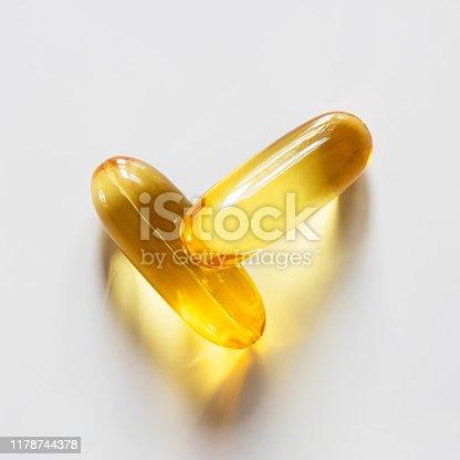 Supplement omega 3 fish oil capsules on white background