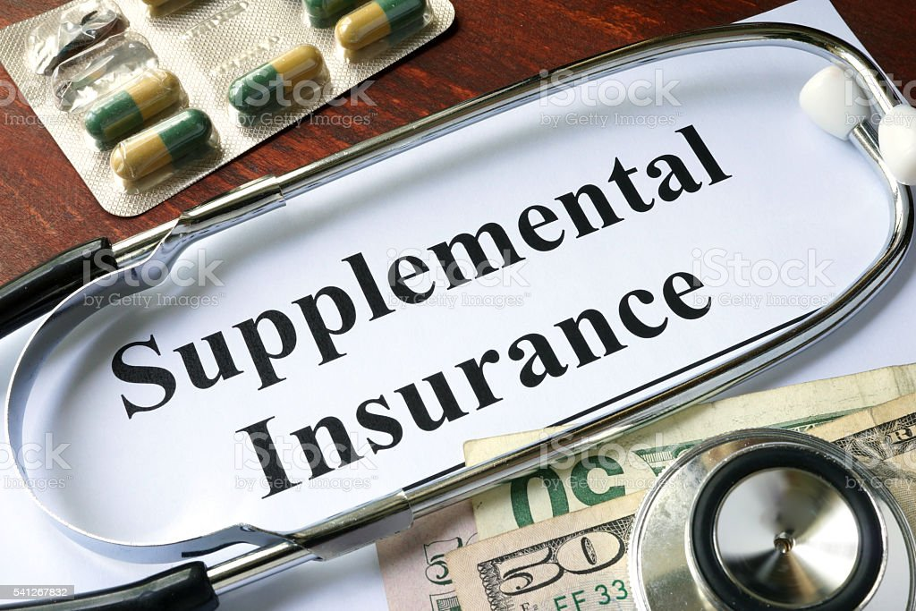 Supplemental Insurance written on a paper.  Medical concept. stock photo
