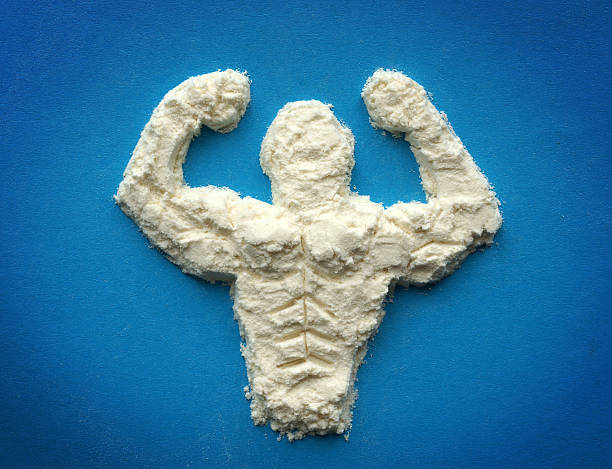 Supplements for bodybuilders, sportmans and healthy eating. male body from protein powder. Supplements for bodybuilders, sportmans and healthy eating. amino acid stock pictures, royalty-free photos & images