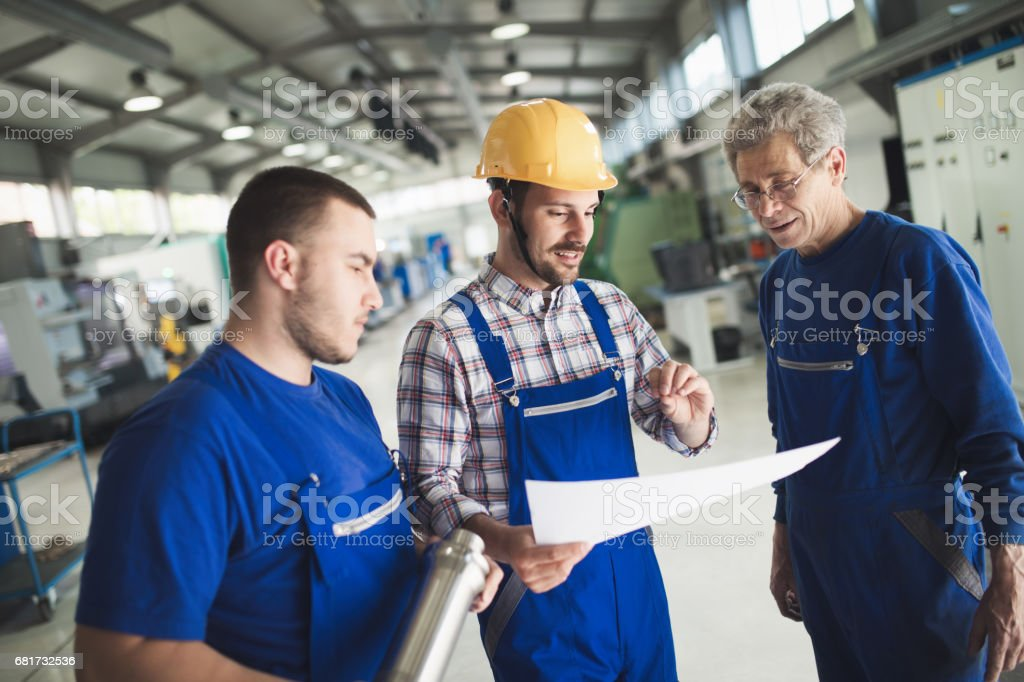 Supplier with engineer checking on production in factory stock photo