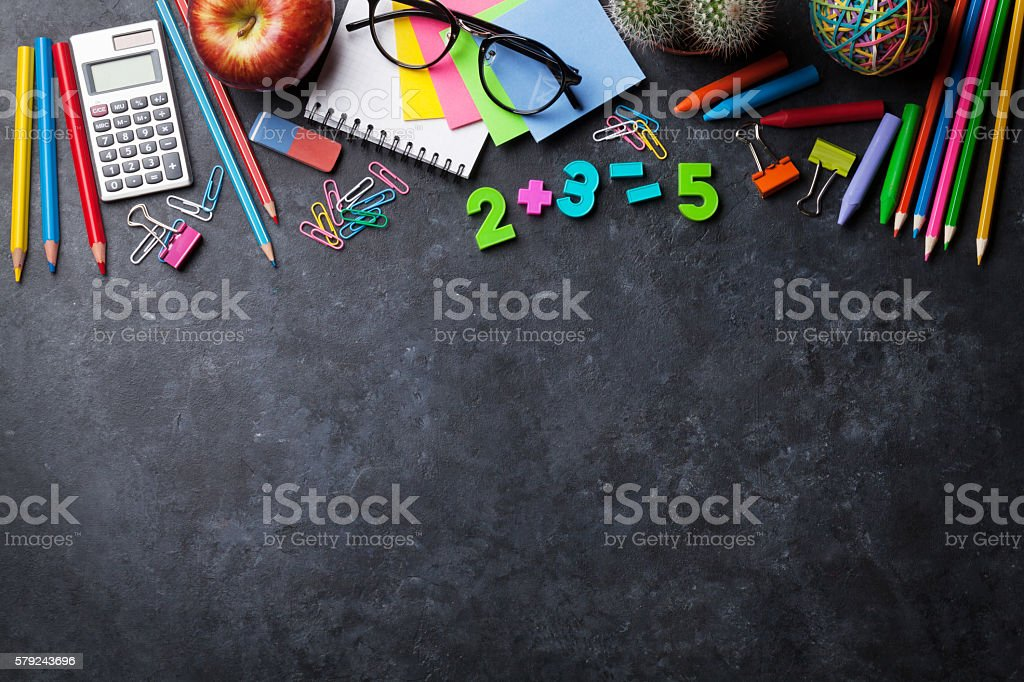 Supplies and apple over chalk board stock photo