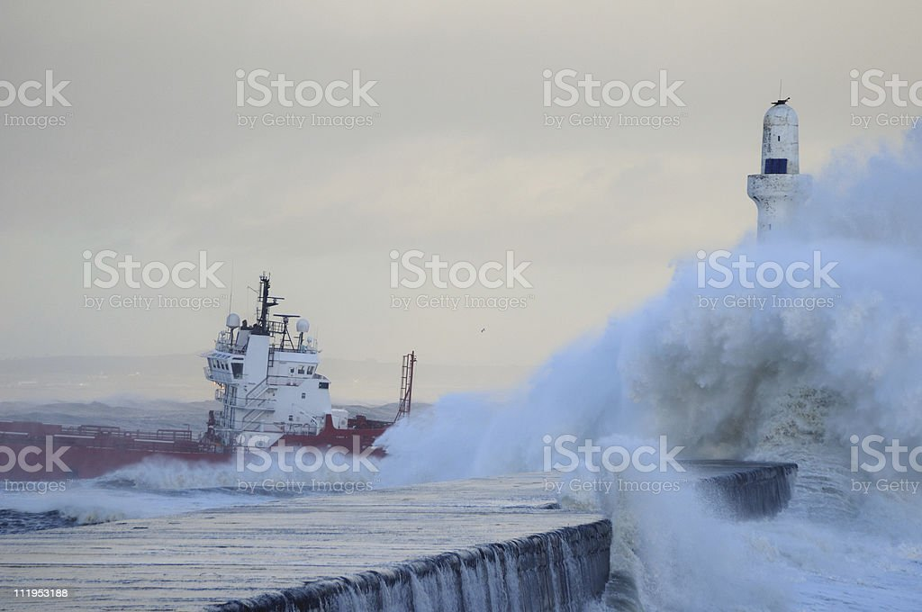 Supply boat leaving Aberdeen on a stormy day stock photo