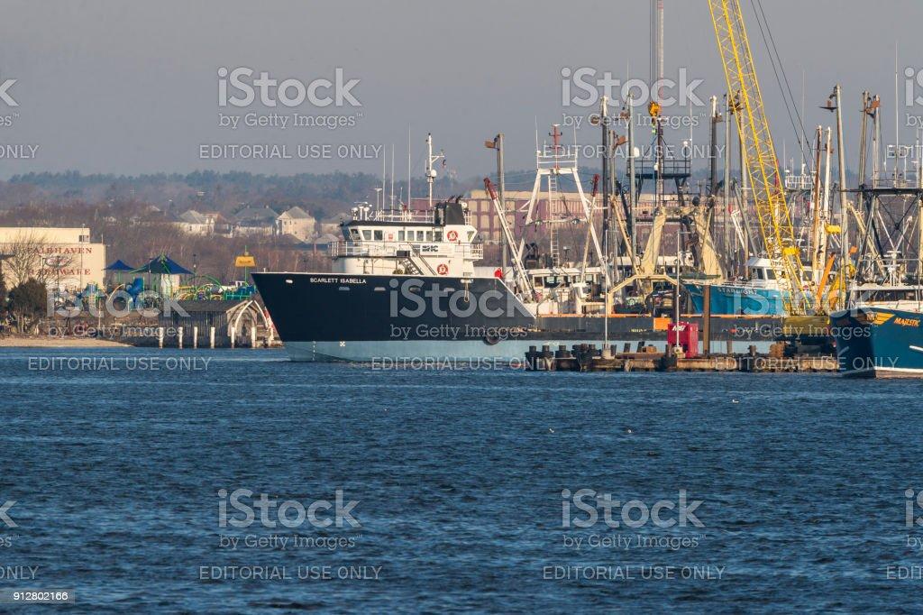 Supply ship Scarlett Isabella docking stock photo