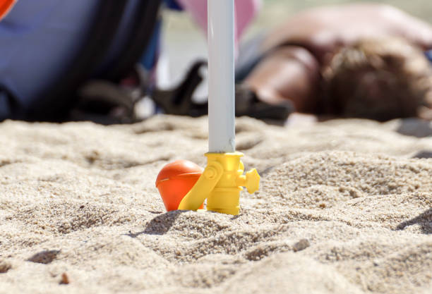 Support for beach umbrella. beach umbrella screw Support for beach umbrella. beach umbrella screw . anchor athlete stock pictures, royalty-free photos & images