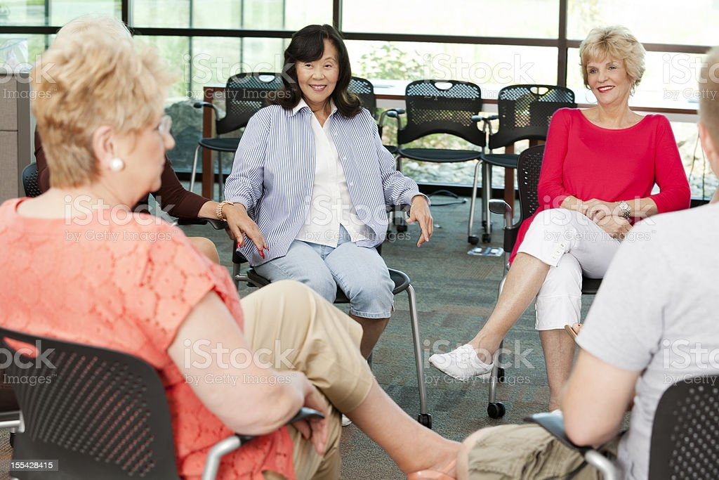 Support group: diverse group of senior women in a circle royalty-free stock photo